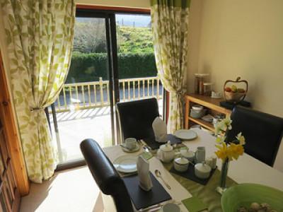 Breakfast room overlooking patio with views to Ben Nevis