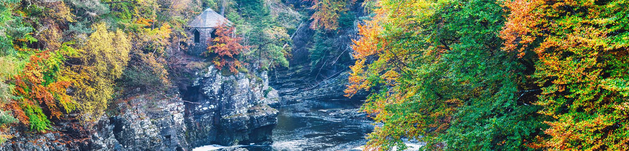 Invermoriston Falls with the Summer House at autumn.