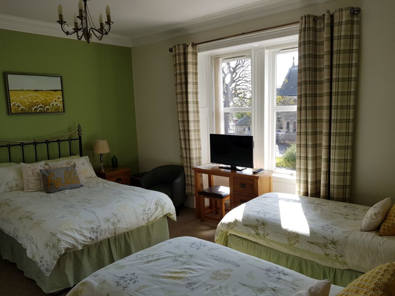 Green room, a large family room with one double and two twin beds, en-suite shower room, tv, hairdryer, toiletries , hospitality tray including homemade shortbread