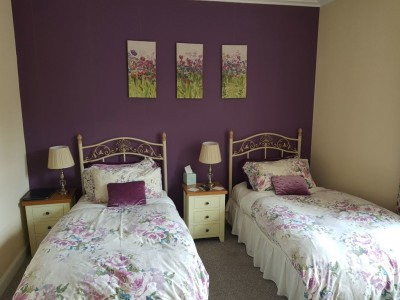 Plum room, a quiet twin room at the rear of the property has an en-suite shower room, toiletries, hairdryer, tv and hospitality tray including homemade shortbread